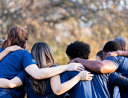 A Group of Young People Embracing